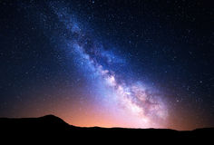 Night landscape with Milky Way. Starry sky, Universe. Night landscape with colorful Milky Way and yellow light at mountains. Starry sky with rocks at summer royalty free stock photos