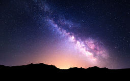 Night landscape with Milky Way. Starry sky, Universe. Night landscape with colorful Milky Way and yellow light at mountains. Starry sky with rocks at summer royalty free stock photo