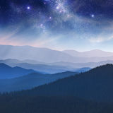 Night landscape in the mountain with stars. Dark blue sky Royalty Free Stock Photography