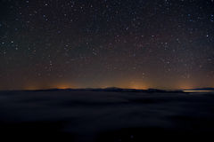 Night landscape with  mountains, sky,  stars Stock Images