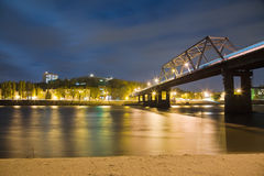 Night landscape, night city with glowing lights, the bridge over the river Royalty Free Stock Image