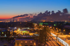 Night landscape with a road in the industrial area of the city Royalty Free Stock Image