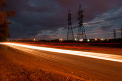 Night landscape, the road on which vehicles travel. Royalty Free Stock Photo