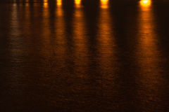 Night landscape, sea, colored lights reflected in water Stock Photography