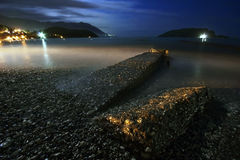 Night landscape with the sea, moon and stones Stock Photos