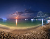Night landscape at the seashore with lunar path. Seascape Royalty Free Stock Photos