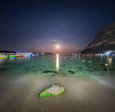 Night landscape at the seashore with stone and lunar path Stock Photography