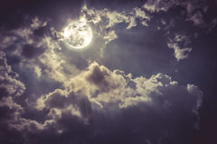 Night landscape of sky with cloudy and bright full moon with shiny. Vintage tone. stock images