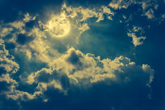 Night landscape of sky with cloudy and bright full moon with shiny. Cross process. royalty free stock image