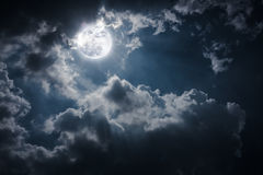 Night landscape of sky with cloudy and bright full moon with shiny. stock photo