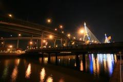Night landscape of small and large bridge. Night landscape of small bridge and large suspension bridge in Bangkok, Thailand Royalty Free Stock Photos