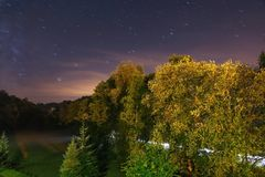Night landscape with stair trails, forest amd way. stock images