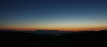 Night landscape. Of the sunset and little village Royalty Free Stock Photography