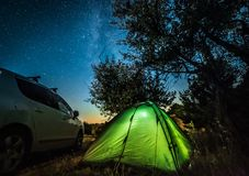 Night landscape with tent and car royalty free stock image