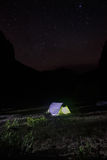 Night landscape with tent pitched on a mountain pasture Stock Photography