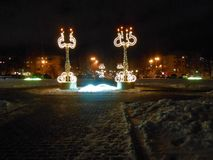 Night new year landscape in the town. stock photos