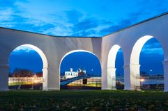 Night landscape of the Veliky Novgorod, Russia. Kremlin and St Sophia cathedral in the arch spans of Yaroslav courtyard. Night cityscape of the Veliky Novgorod Royalty Free Stock Photography