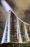 Night landscape view of marina bay sands slow shutter blur. Lights and cloud Royalty Free Stock Photos