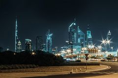 Night landscape with views of the skyscrapers and the Burj Khalifa from the side of the road.  royalty free stock photo