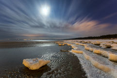 Night landscape in winter sea beach in the moonlight,Baltic sea Stock Photos