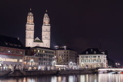 Night landscape of Zurich with Grossmunster church Royalty Free Stock Image