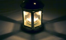 Night Lantern. A shot of a beautiful candle-lit lantern with stars at night Royalty Free Stock Images