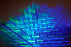Night laser show. Night laser party show. Colorful nightclub blue light in sky Royalty Free Stock Photo