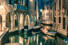 Night lateral canal and bridge in Venice, Italy Stock Images