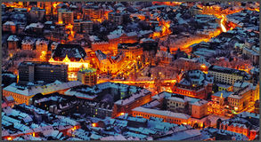 Night lava scenery of medieval city Brasov, Transylvania in Romania with Council Square, Black Church and Citadel view from Tampa. Lava scenery of medieval city stock photos