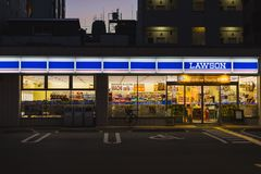 Night Lawson convenience store in Japan. Osaka, Japan - November 11, 2015 : Night Lawson convenience store in Japan. Lawson is small shopping minimart opening 24 Royalty Free Stock Image