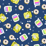 Night leisure in an armchair watching TV with a donut seamless pattern Royalty Free Stock Images