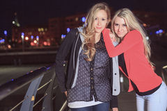 Night life portrait of two friends Stock Image