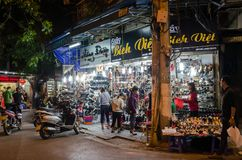 Night life of the street view in Hanoi Old Quarter, people can seen exploring and shopping around it. Royalty Free Stock Image