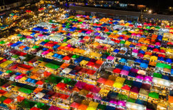 Night light aerial view multiple colours roof top weekend market. Cityscape background stock photo