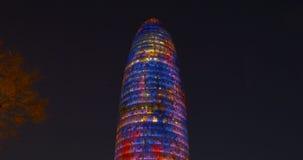 Night light barcelona famous agbar tower ilumination 4k spain stock video
