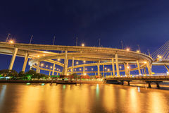 Night light bridge with river at bangkok Stock Images