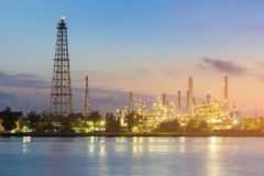 Night light over petroleum refinery factory river front. Industrial background stock images
