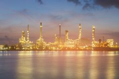 Night light petrol refinery river front. At twilight stock image