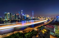 Night Light of Shanghai. Boat sailing track acrossing the Huangpu River, which separates the Bund and CBD of Shanghai Royalty Free Stock Photos