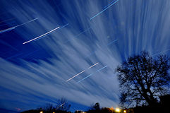 Night light with star trails and clouds Stock Photo