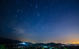 Night light with star trails Stock Photos