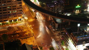 Night light traffic silom crossroad metro line roof top view 4k time lapse thailand stock video