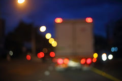 Night light of truck car on the city street, abstract blur bokeh Royalty Free Stock Photography