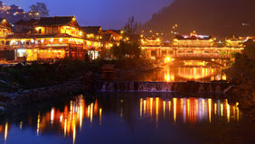 Night lighting constructions in the Chinese village of ethnic mi Stock Photography