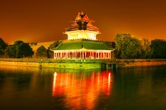 Night lighting corner towers of the Forbidden City. Beijing, China. royalty free stock image