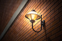 Night lighting lamp. Night lighting lamp on the brick wall vintage style outdoor walkway walking university or college space decoration royalty free stock photography