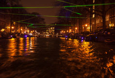 Night lighting reflections in Amsterdam channels from moving cruise boat. Blurred abstract photo as background. Royalty Free Stock Photos
