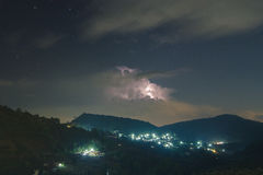 Night lightning strike over mountains resort with star on Mon Jam Royalty Free Stock Image