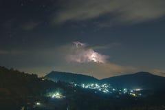 Night lightning strike over mountains resort with star on Mon Jam Royalty Free Stock Image