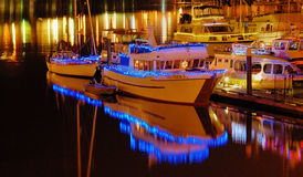 Night lights on boats Stock Images